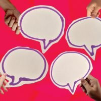 Illustration of 4 different hands holding speech bubbles